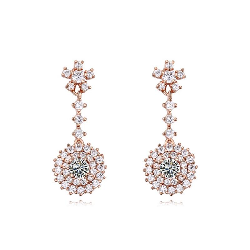 Boucles d'oreilles dorées or rose, oxydes de zirconium , Milady